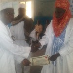 Alhaji Nura Mustapha representing District head of Babura presenting certificate to CITAD